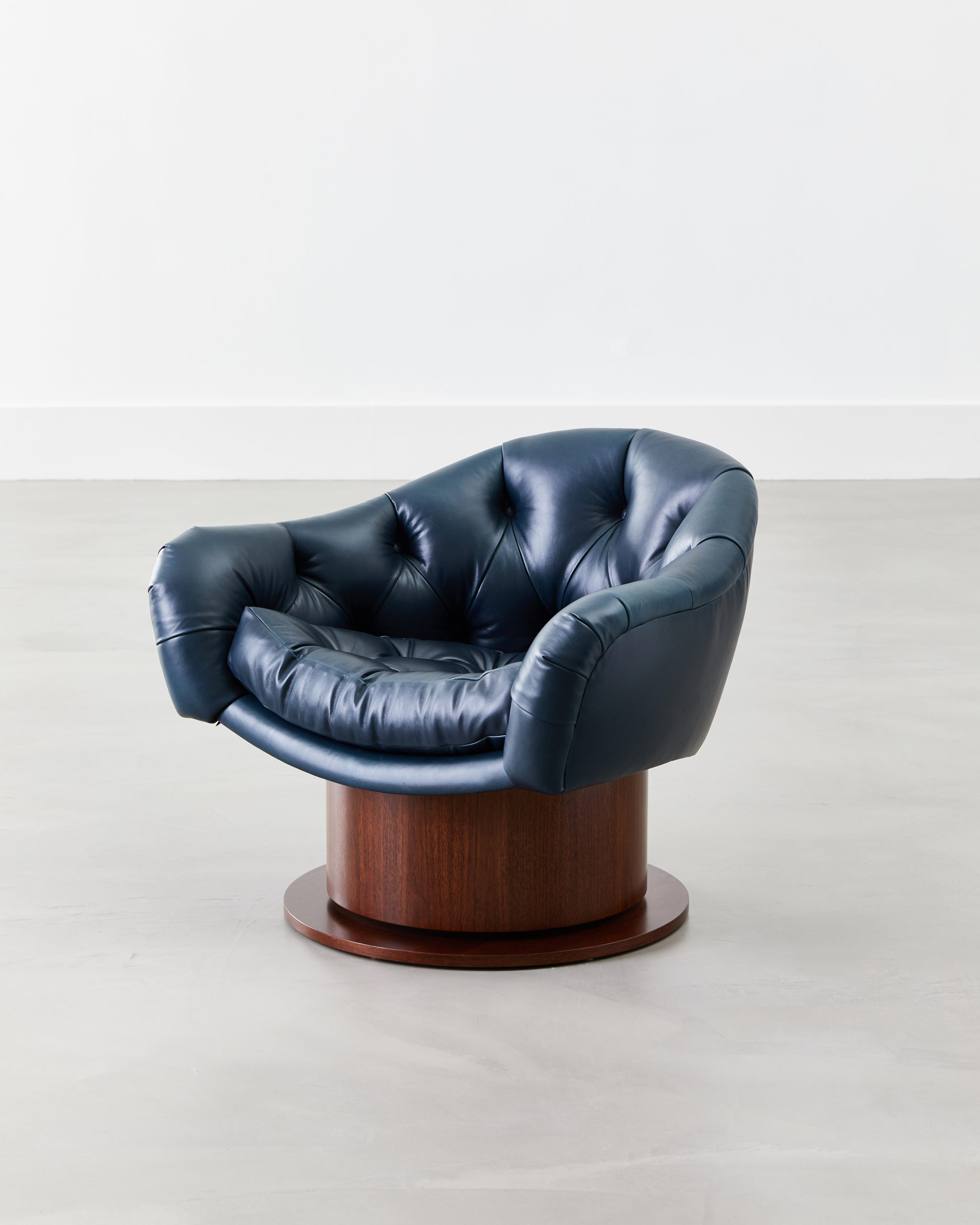Turn Around Swivel Club Chair, Wood Base by COUP STUDIO